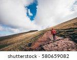 girl hiking the pen y fan...   Shutterstock . vector #580659082