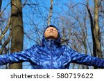 woman with open arms in forest  ... | Shutterstock . vector #580719622