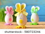colored easter eggs bunny.... | Shutterstock . vector #580723246