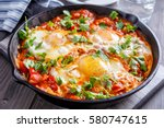 tasty and healthy  shakshuka in ... | Shutterstock . vector #580747615