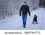 cute son with father outdoor....   Shutterstock . vector #580794772
