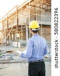 engineer builder with blueprint ... | Shutterstock . vector #580822396
