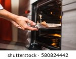woman cooking in the kitchen ... | Shutterstock . vector #580824442