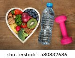 healthy food in heart shaped... | Shutterstock . vector #580832686