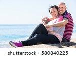positive charming mature couple ... | Shutterstock . vector #580840225