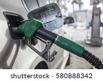 to fill the machine with fuel.... | Shutterstock . vector #580888342