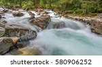 rushing mountain river in the... | Shutterstock . vector #580906252