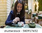 young woman having breakfast at ...   Shutterstock . vector #580917652