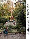 Small photo of Kaatsheuvel, the Netherlands - 3 November 2016: Two kids admiring 'langnek' in the Efteling.