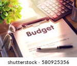 budget on clipboard with sheet... | Shutterstock . vector #580925356