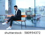 entrepreneur smiling man  puts...   Shutterstock . vector #580954372