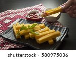polenta fries with tomato sauce ... | Shutterstock . vector #580975036