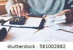 man using calculator and... | Shutterstock . vector #581002882
