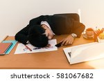 businessman sleeping at his... | Shutterstock . vector #581067682