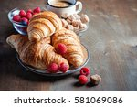 coffee and croissants with... | Shutterstock . vector #581069086