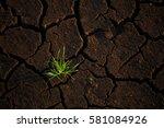 green grass growing up on crack ... | Shutterstock . vector #581084926