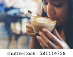 women drinking coffee... | Shutterstock . vector #581114728