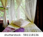 Small photo of Basic amenities on a bed with mosquito net in resort
