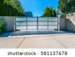 modern gates with driveway to... | Shutterstock . vector #581137678