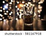 handsome man holding glass of...   Shutterstock . vector #581167918
