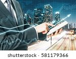 man using digital pad on night... | Shutterstock . vector #581179366