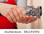 electrician mounting the wires... | Shutterstock . vector #581193592
