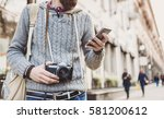 traveler man using mobile phone ... | Shutterstock . vector #581200612