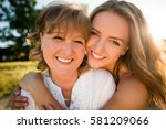 portrait of mother and her... | Shutterstock . vector #581209066