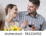 Small photo of Young married couple smiling during dinner with wine