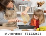 woman with beige apron pouring... | Shutterstock . vector #581233636