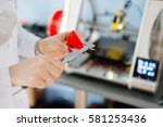 woman checking the dimensions... | Shutterstock . vector #581253436