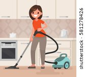 woman housewife vacuuming the...