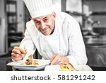 closeup of smiling male chef... | Shutterstock . vector #581291242