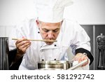 focused chef tasting sauce with ... | Shutterstock . vector #581292742