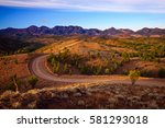 a winding road runs through... | Shutterstock . vector #581293018
