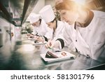 chefs standing in a row... | Shutterstock . vector #581301796