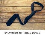 tie on old wood background.... | Shutterstock . vector #581310418