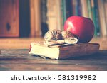 old vintage book on wooden... | Shutterstock . vector #581319982