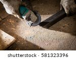worker used electric wheel... | Shutterstock . vector #581323396