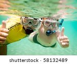 Two children under water in masks - stock photo