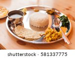 a nepali thali  dal bhat  set... | Shutterstock . vector #581337775