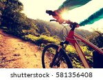 young woman cyclist riding... | Shutterstock . vector #581356408