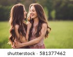 beautiful happy young twins...   Shutterstock . vector #581377462