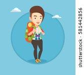 caucasian traveler standing... | Shutterstock .eps vector #581442856