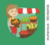 young greengrocer standing near ... | Shutterstock .eps vector #581466436
