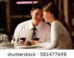 couple in restaurant  sitting... | Shutterstock . vector #581477698