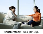 mother and daughter sitting... | Shutterstock . vector #581484856