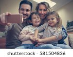 family taking self portrait on...   Shutterstock . vector #581504836