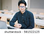 male indian student in glasses... | Shutterstock . vector #581522125