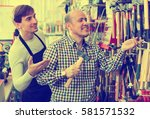 positive smiling customer and... | Shutterstock . vector #581571532